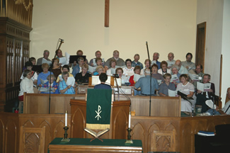 AlumniWeekend2003ChoirRehearsal.jpg