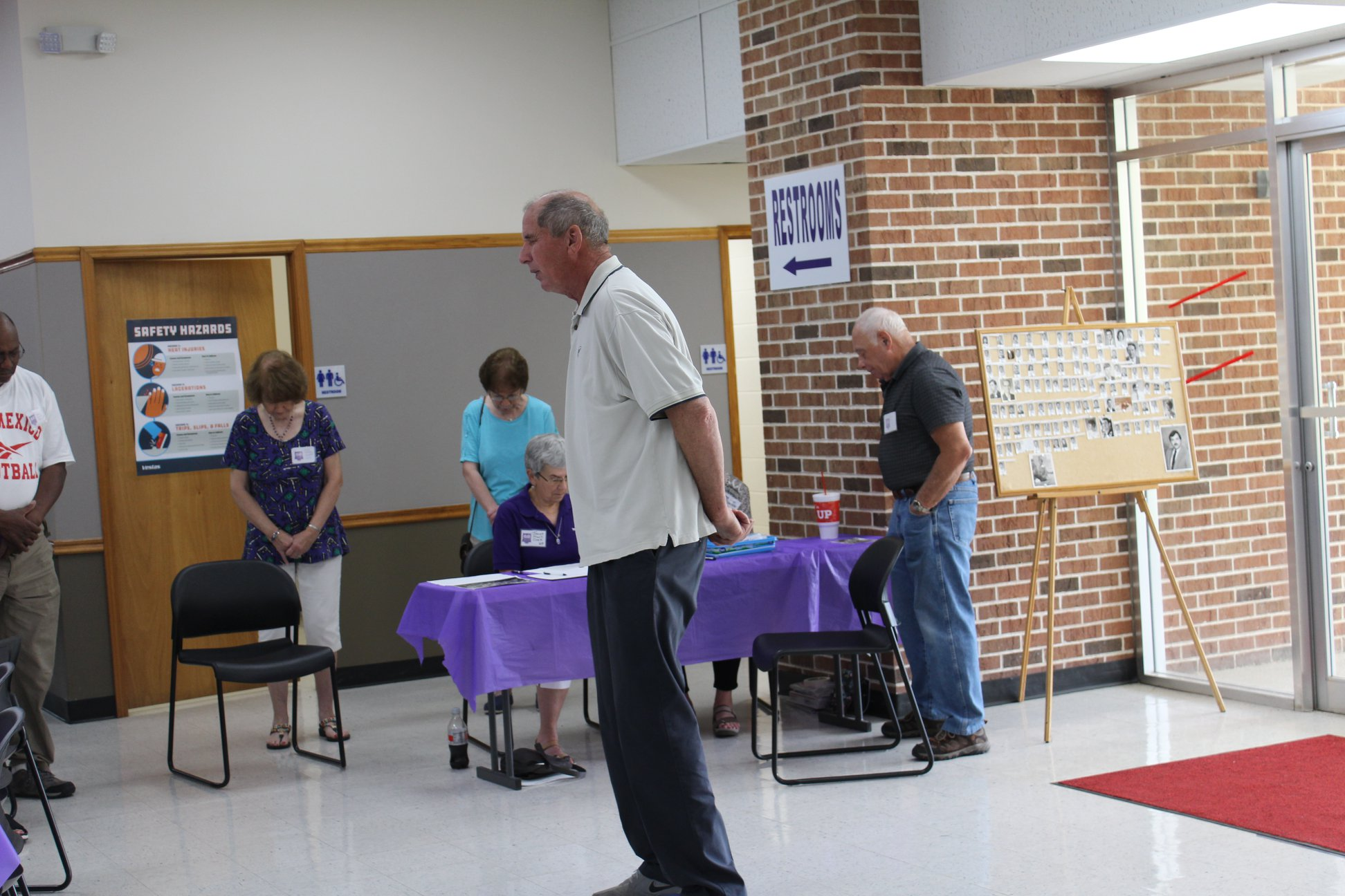 Bill Slaughter leads the prayer before lunch.jpg