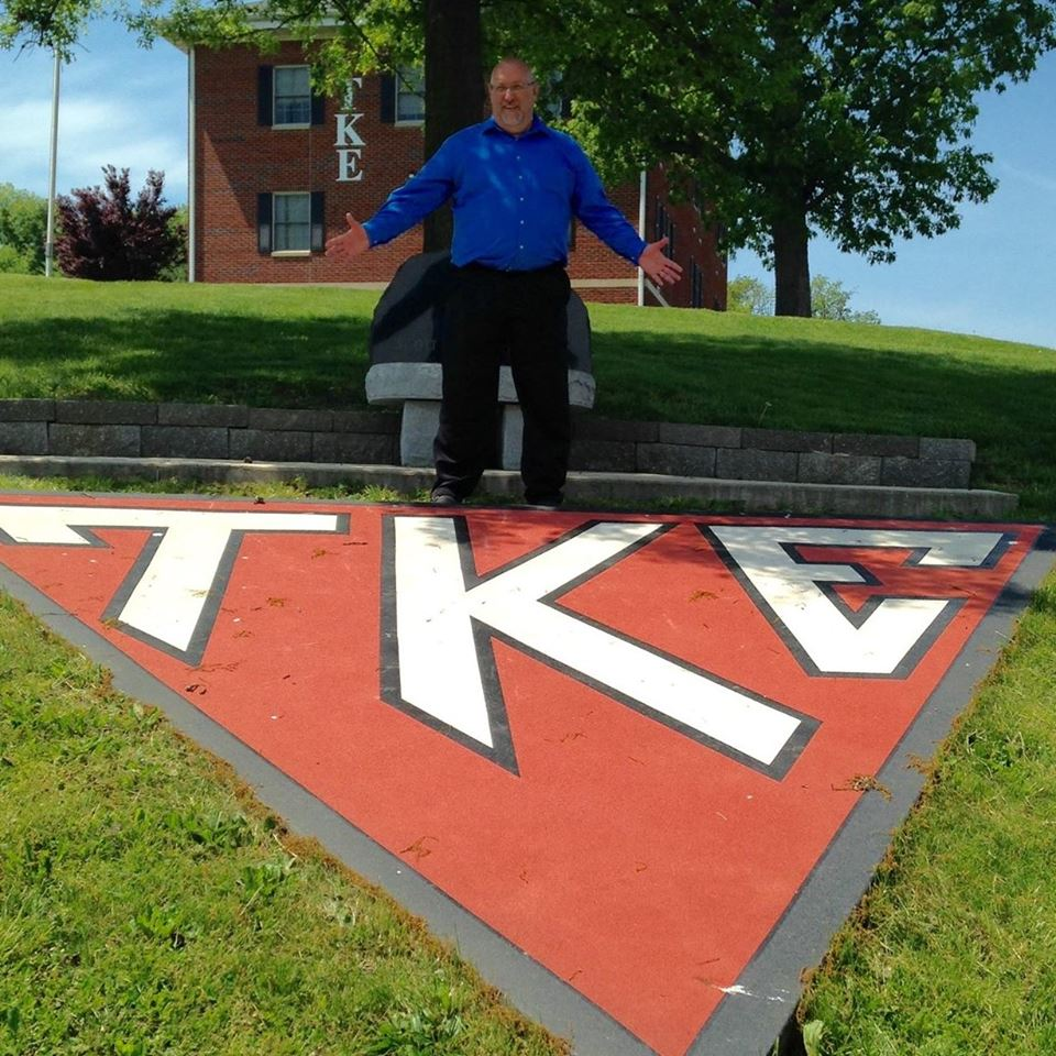Curt Riley with TKE sign.jpg