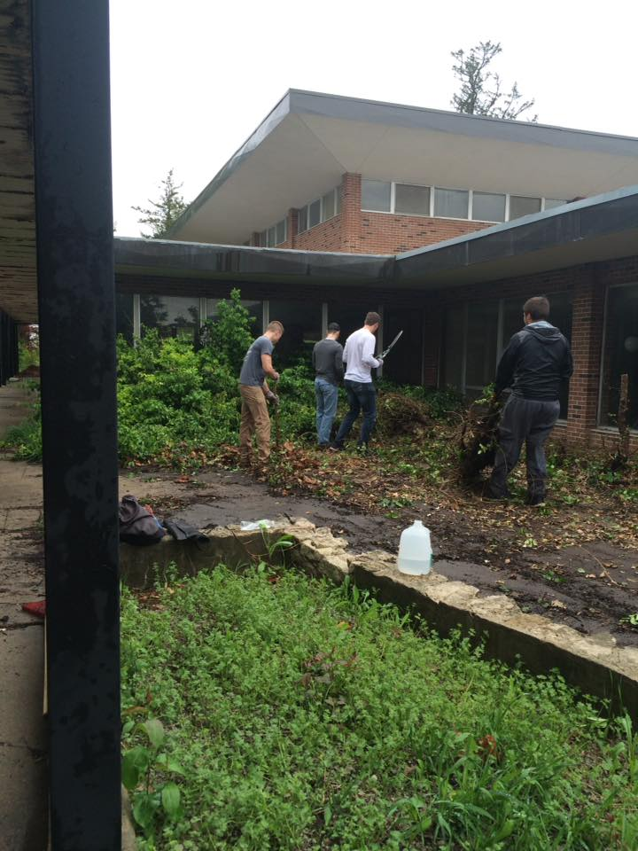 April 30 2016 2 Epsilon Omicron colony of Alpha Sigma Phi fraternity from MWSU in St. Joseph helping with clean up.jpg